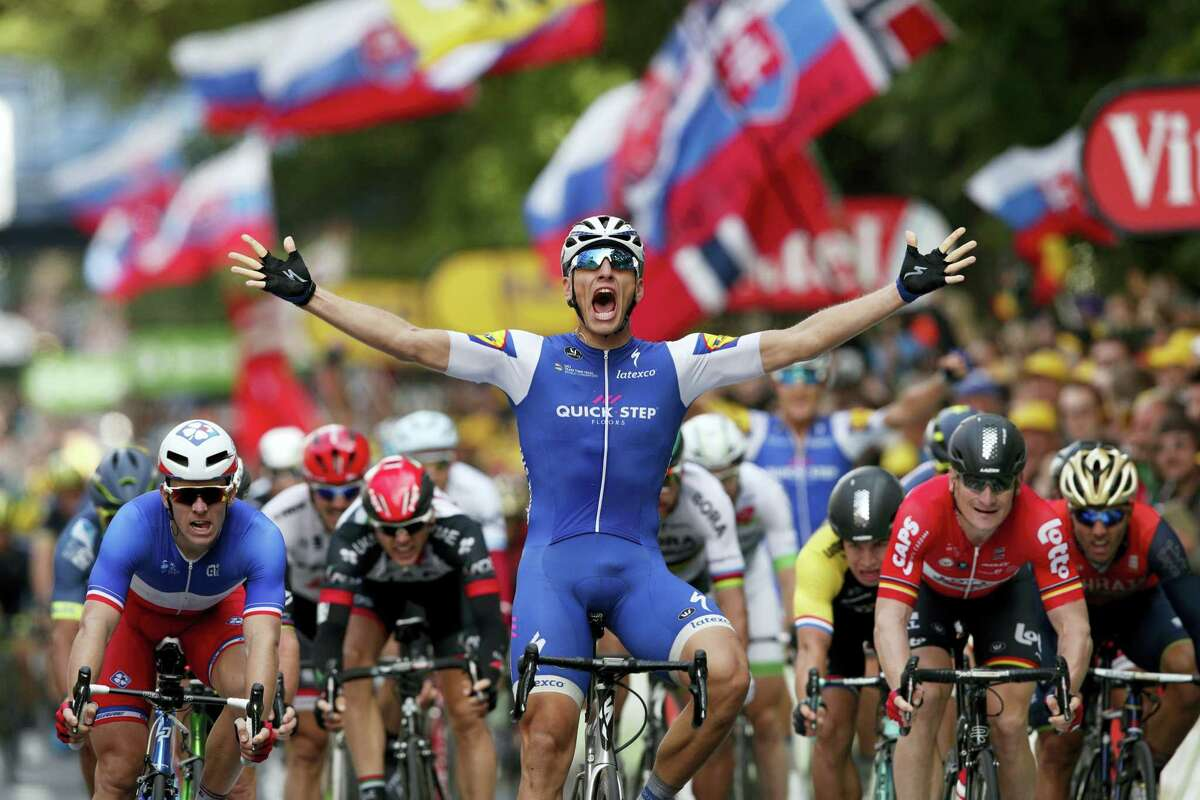Germany's Marcel Kittel celebrates as he crosses the finish line to win the second stage of the Tour de France cycling race over 203.5 kilometers (126.5 miles) with start in Dusseldorf, Germany, and finish in Liege, Belgium on July 2, 2017.