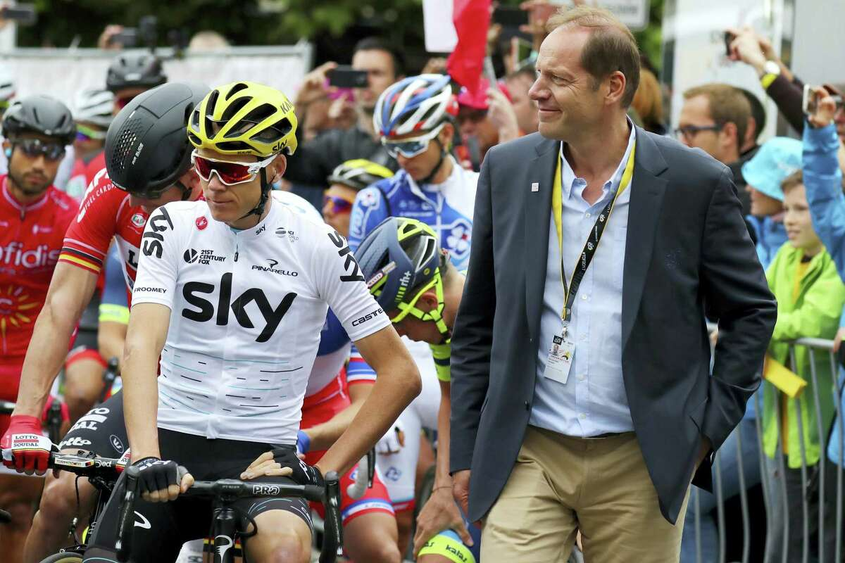 Britain's Christopher Froome of the Sky Team, left, waits next to the director of the Tour de France, Christian Prudhomme, ahead of the start of the Dusseldorf-Liege, 2nd stage of the Tour de France 2017, in Duesseldorf, Germany on July 2, 2017.