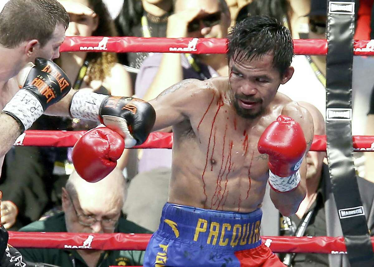 Manny Pacquiao, right, and Jeff Horn fight during their WBO World welterweight title bout in Brisbane, Australia, on Sunday.