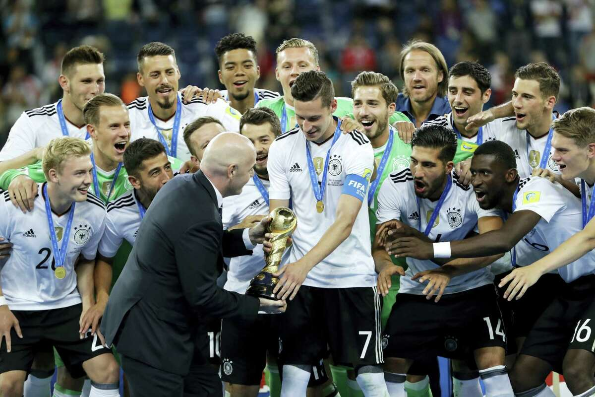 Germany's Julian Draxler is given the trophy by FIFA President Gianni Infantino, at the end of the Confederations Cup final at the St.Petersburg Stadium in Russia on Sunday.