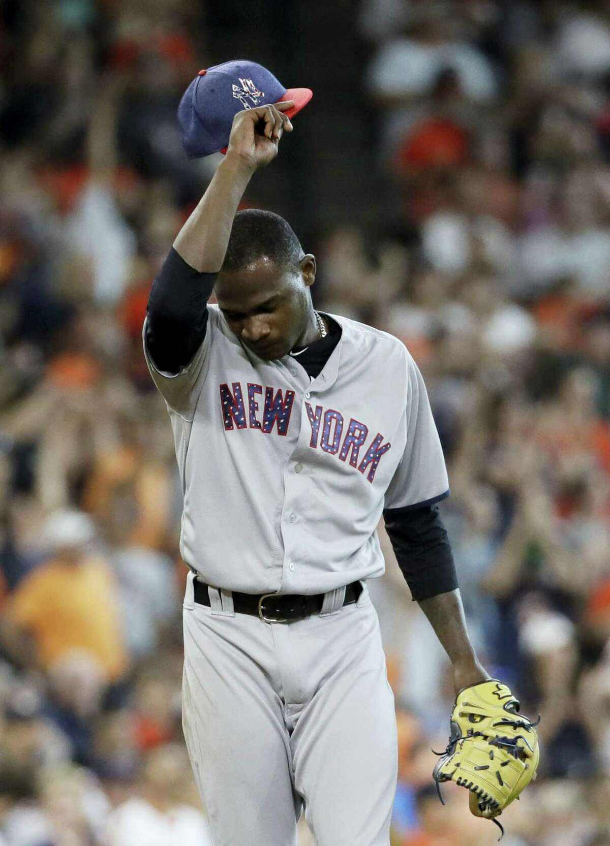 Yankees pitcher Domingo German wipes his head after giving up a two-run home run to Yuli Gurriel during the seventh inning on Sunday.