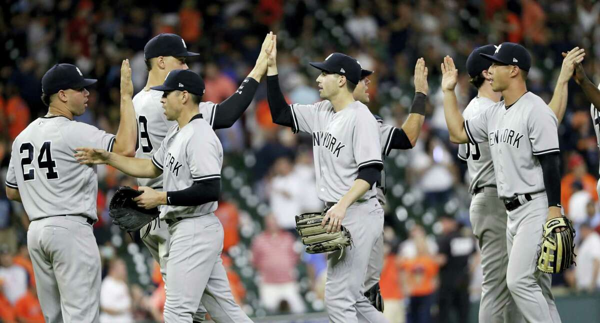 The Yankees celebrate after the team's 13-4 win over the Astros on Friday.