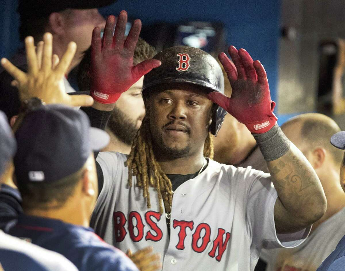 Hanley Ramirez gets high-fives in the dugout after scoring the go-ahead run during the 11th inning.