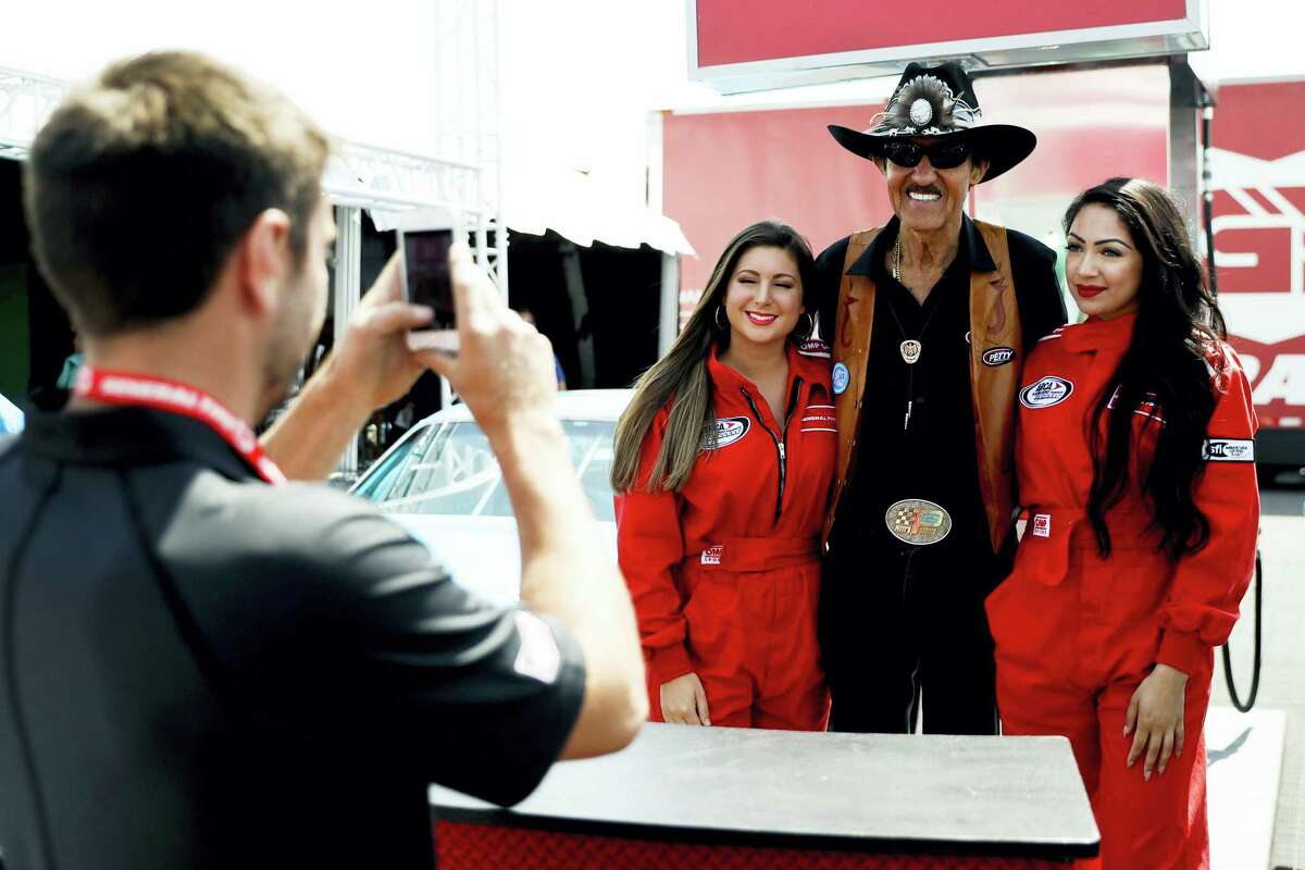 Richard Petty poses for a photo at a sponsor's event during the NASCAR Cup Series Pocono 400 auto race weekend in Long Pond, Pa.