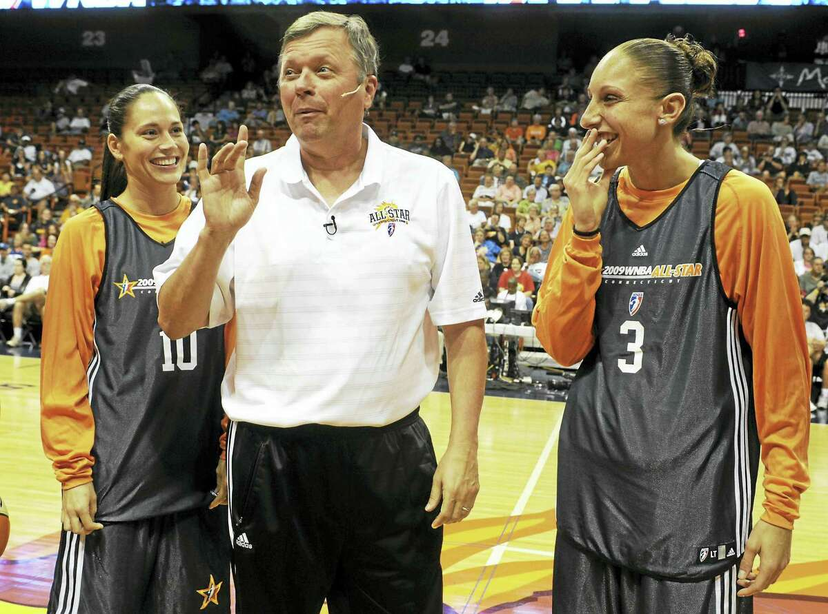 During a practice for the 2009 WNBA All-Star game at the Mohegan Sun Arena, San Antonio head coach Dan Hughes joked with former UConn stars Sue Bird, left, and Diana Taurasi.