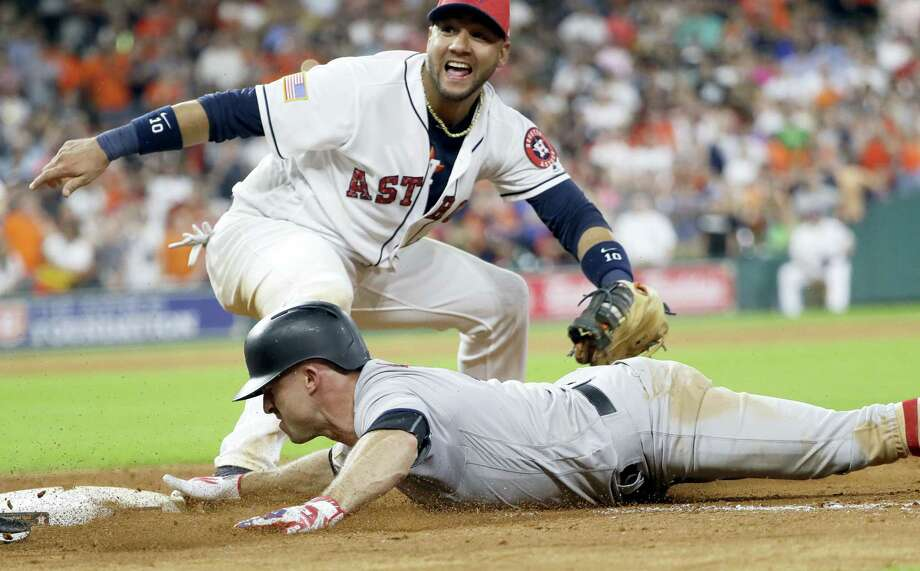 The Yankees' Brett Gardner, right, is tagged out by Astros first baseman Yuli Gurriel to end the game on Saturday in Houston. Photo: David J. Phillip — The Associated Press  / Copyright 2017 The Associated Press. All rights reserved.
