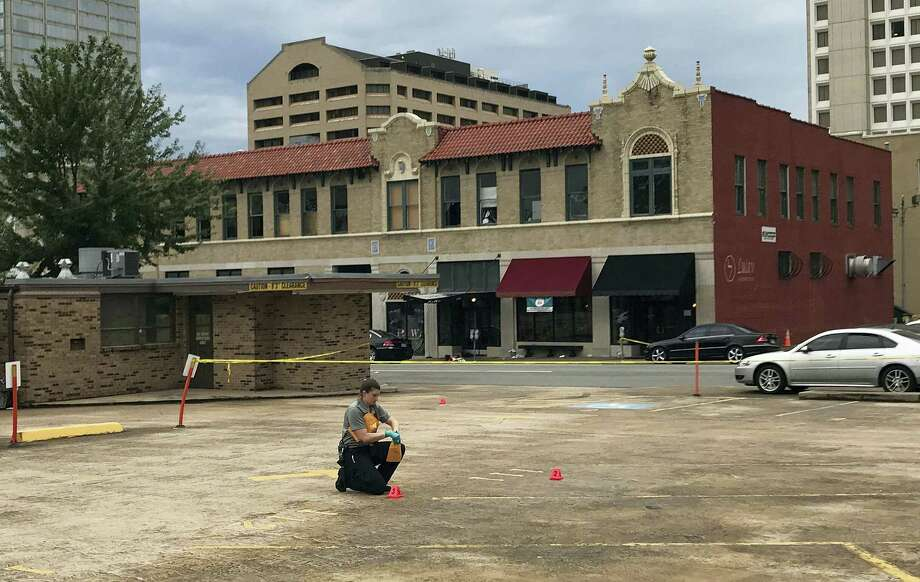 An investigator collects evidence near an Arkansas nightclub where police say multiple people were shot, Saturday, July 1, 2017, in Little Rock, Ark. Photo: AP Photo/Andrew DeMillo   / Copyright 2017 The Associated Press. All rights reserved.