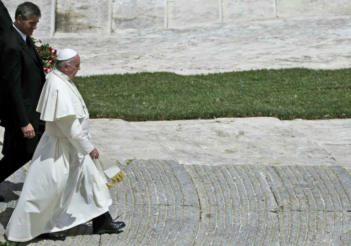 Pope Francis leaves with his butler Sandro Mariotti, at the end of a special mass for Roman holiday of St. Peter and St. Paul in St. Peter's square at the Vatican, Thursday, June 29, 2017.