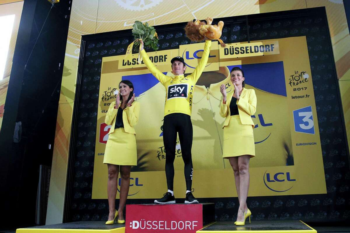 Britain's Geraint Thomas celebrates his overall leader's yellow jersey after winning the first stage of the Tour de France cycling race, an individual time trial over 14 kilometers (8,7 miles), with start and Finish in Duesseldorf, Germany, Saturday, July 1, 2017.
