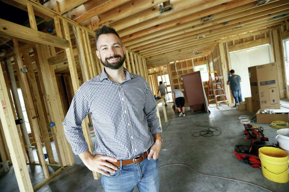 Zach Tyson, owner of Tyson Construction, poses for a photo inside a home he is constructing in Destrahan, La.