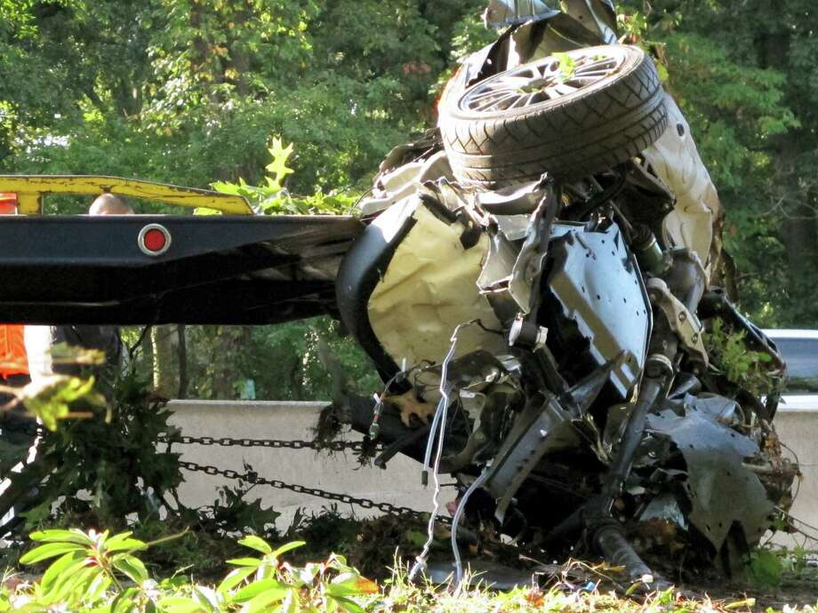 This file photo shows the wrecked Subaru Impreza in which four people died as it is loaded onto a flatbed truck on the Southern State Parkway in West Hempstead, N.Y., after and early-morning accident. At the wheel was a New York teenager, Joseph Beer, who had smoked about $20 worth of marijuana, before getting into the car with four friends, and driving over 100 mph before crashing into trees with such force that it split the car in half. As states liberalize their marijuana laws, public officials and safety advocates worry that more drivers high on pot will lead to a spike in traffic deaths. Researchers who have studied the issue, though, are divided over whether toking before taking the wheel in fact leads to more accidents. Photo: AP Photo — Frank Eltman, File  / AP