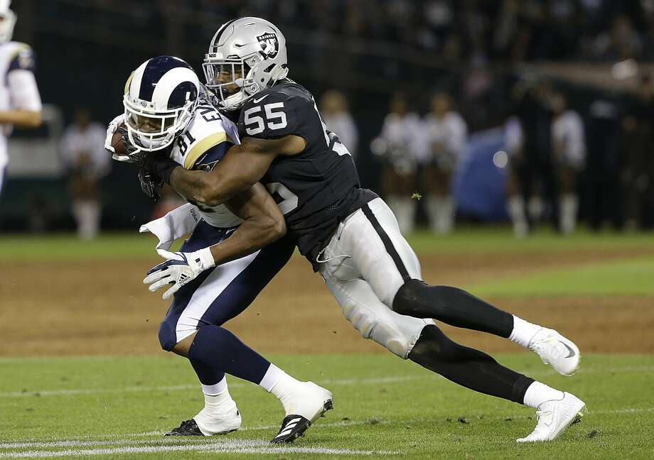 Oakland Raiders linebacker Marquel Lee (55) tackles Los Angeles Rams tight end Gerald Everett during the first half of an NFL preseason football game in Oakland, Calif., Saturday, Aug. 19, 2017. (AP Photo/Rich Pedroncelli) Photo: Rich Pedroncelli, Associated Press