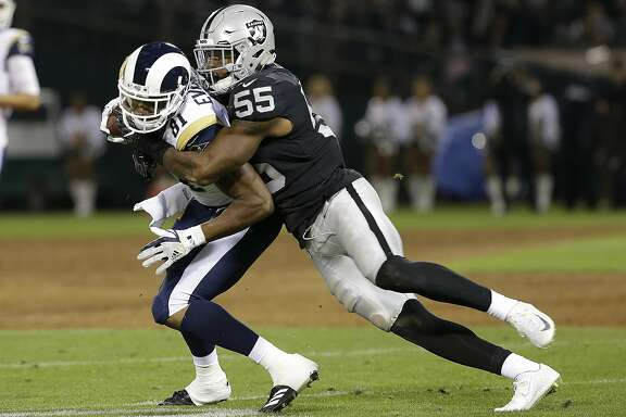 Oakland Raiders linebacker Marquel Lee (55) tackles Los Angeles Rams tight end Gerald Everett during the first half of an NFL preseason football game in Oakland, Calif., Saturday, Aug. 19, 2017. (AP Photo/Rich Pedroncelli)