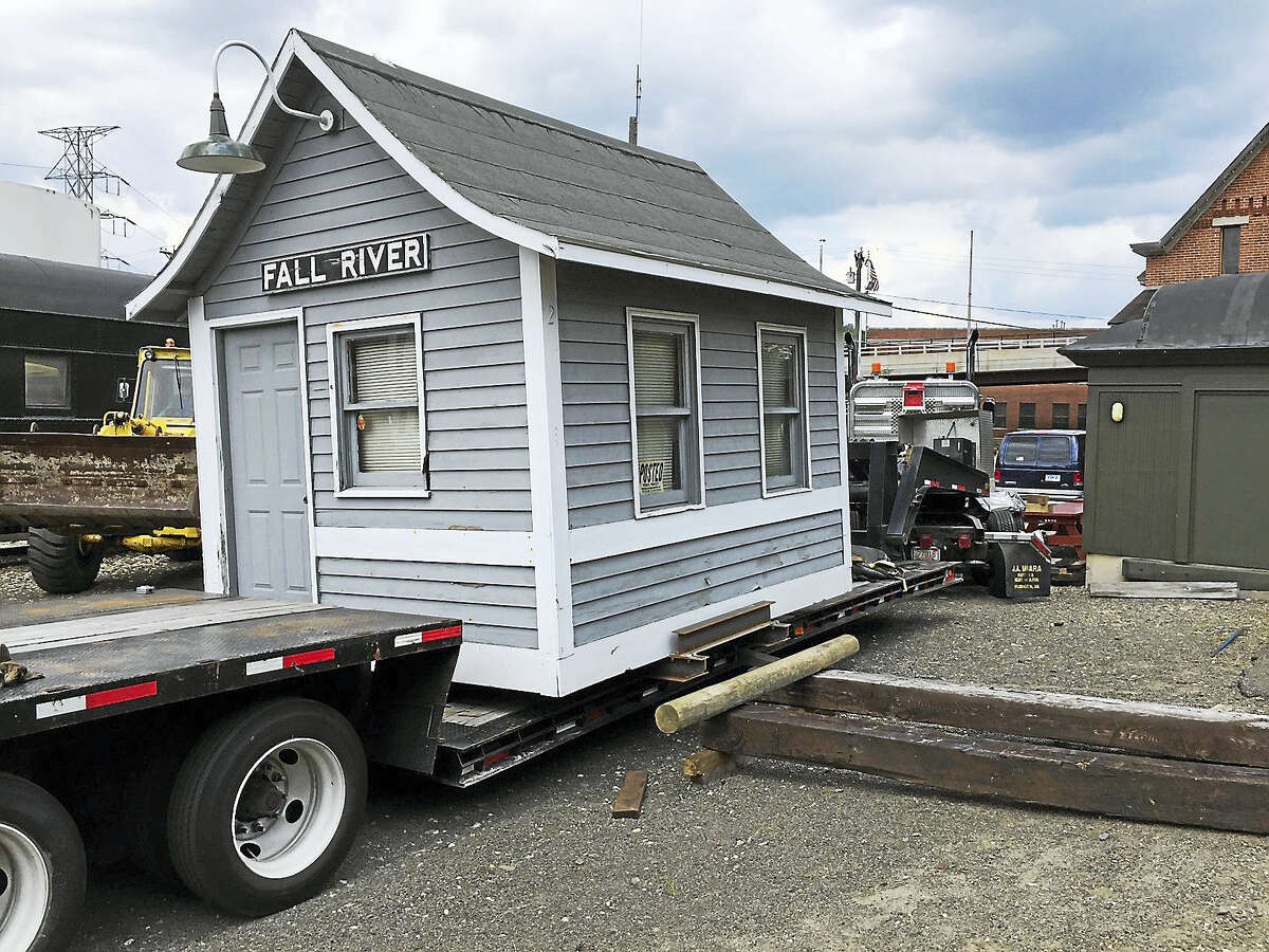 The vintage building is unloaded at the Railroad Museum of New England.