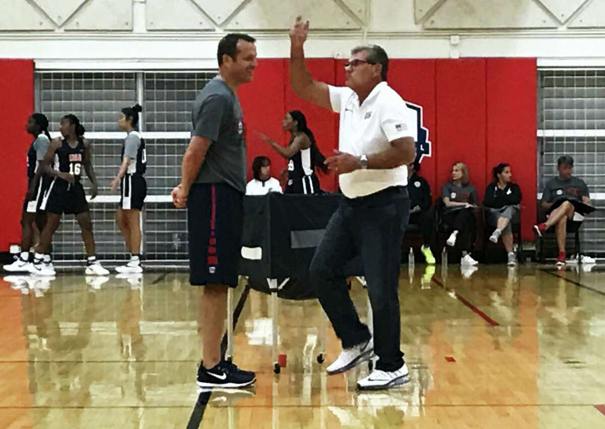 UConn head coach Geno Auriemma, right, and Louisville head coach Jeff Walz talk during the US Under-23 training camp in Colorado Springs, Colo. on Monday.