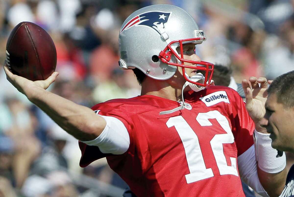 Patriots quarterback Tom Brady throws a pass at training camp on Tuesday in Foxborough, Mass.