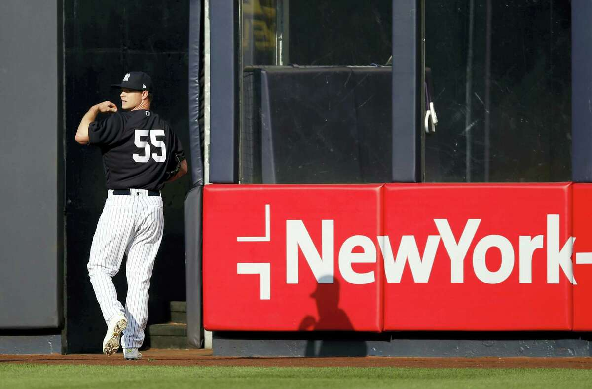 Yankees starting pitcher Sonny Gray looks over his shoulder after throwing in the outfield at Yankee Stadium in New York, on Tuesday.