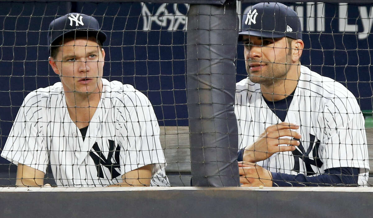 Yankees starting pitchers Sonny Gray, left, and Jaime Garcia look on during Tuesday's game at Yankee Stadium.
