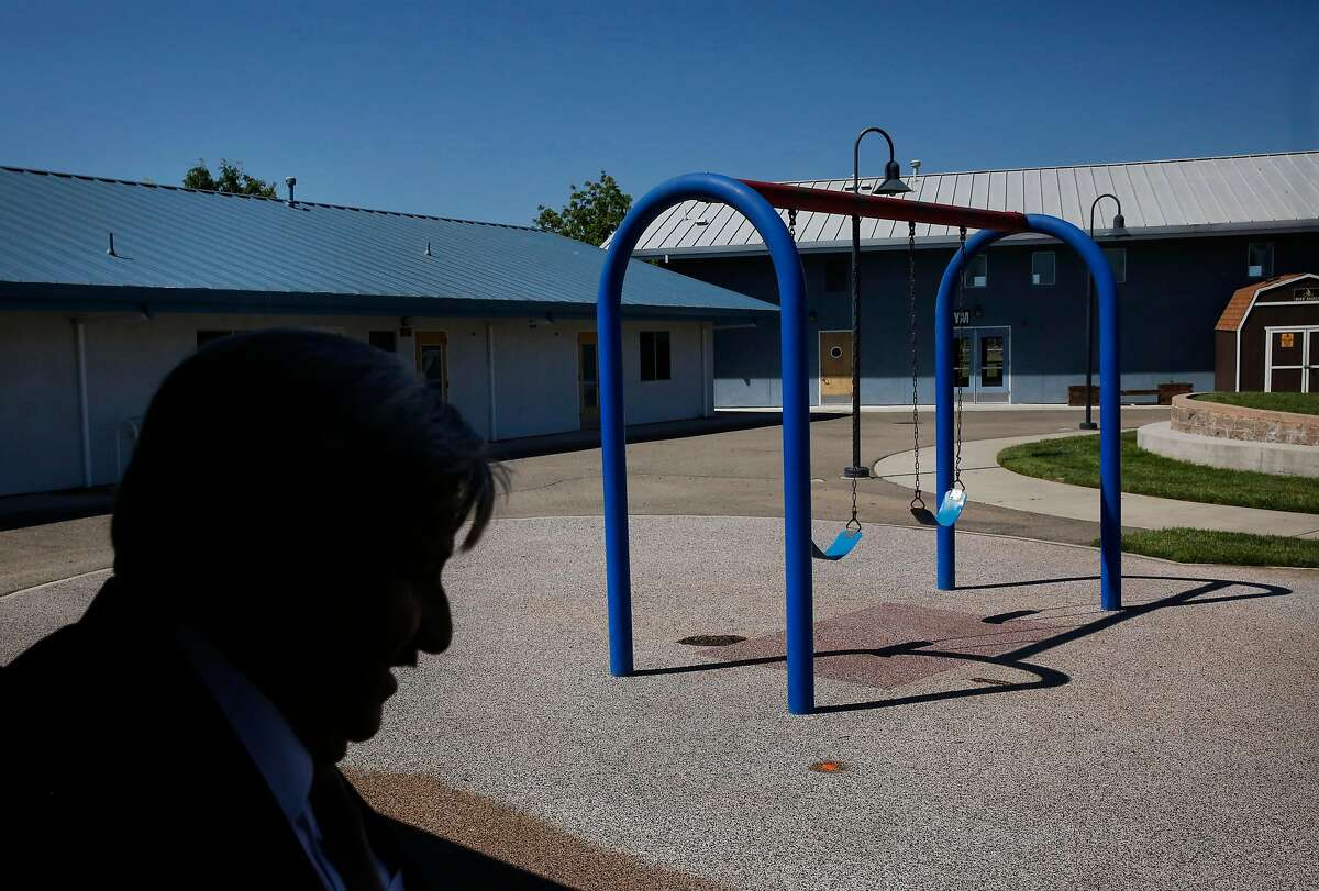 Michael Miller, Director of San Joaquin County�s Human Services Agency stands near a swing set during a Chronicle tour of Mary Graham Children's Shelter April 21, 2017 in French Camp, Calif.