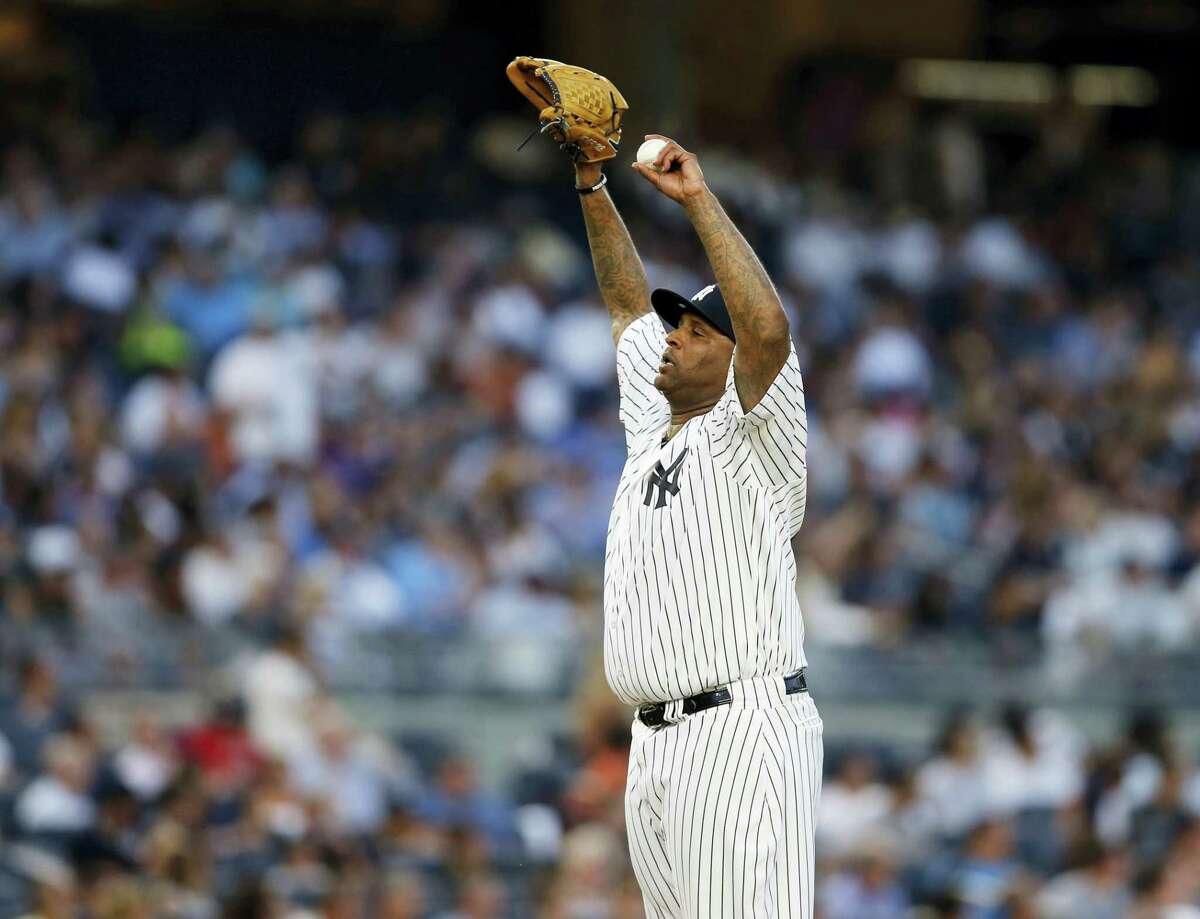 Yankees starting pitcher CC Sabathia reacts after allowing John Hicks' home run.