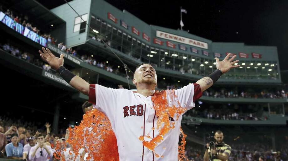 The Red Sox's Christian Vazquez is doused with energy drink after his three-run home run in the bottom of the ninth inning on Tuesday. Photo: Charles Krupa — The Associated Press  / Copyright 2017 The Associated Press. All rights reserved.