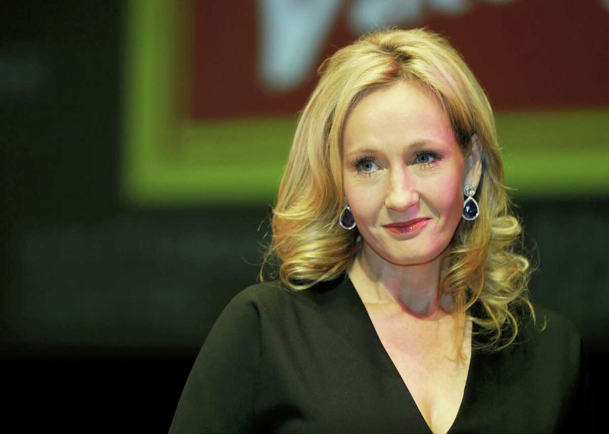 """This is a Thursday, Sept. 27, 2012, file photo of British author J.K. Rowling as she poses for the photographers during photo call to unveil her new book, entitled: """"The Casual Vacancy"""", at the Southbank Centre in London. J.K. Rowling apologized on Tuesday, Aug. 1, 2017, for tweets alleging that U.S. President Donald Trump refused to shake the hand of a disabled boy."""