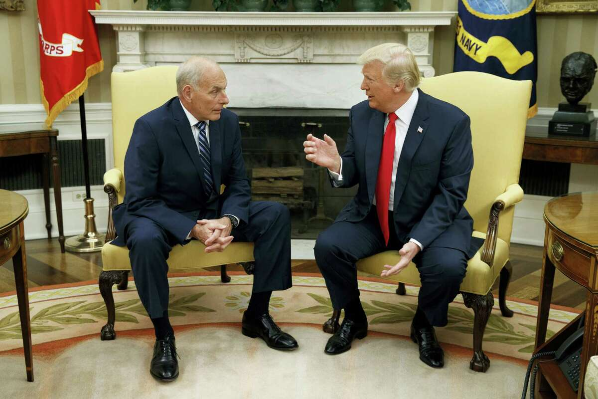 President Donald Trump talks with new White House Chief of Staff John Kelly after he was privately sworn in during a ceremony in the Oval Office with President Donald Trump, Monday, July 31, 2017, in Washington.