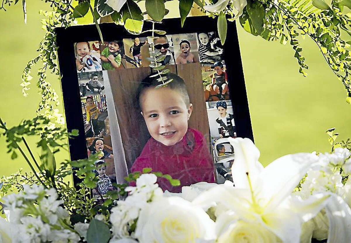 This July 19, 2017, file photo shows a portrait of 5-year-old Aramazd Andressian Jr. at a memorial in his memory at the Los Angeles County Arboretum in Arcadia, Calif. Aramazd Andressian Sr. has pleaded guilty to killing his son. Andressian Sr. entered the plea to first-degree murder Tuesday, Aug. 1, 2017, in Los Angeles County Superior Court in Alhambra, Calif. He previously pleaded not guilty to a murder charge and was being held on $10 million bail.