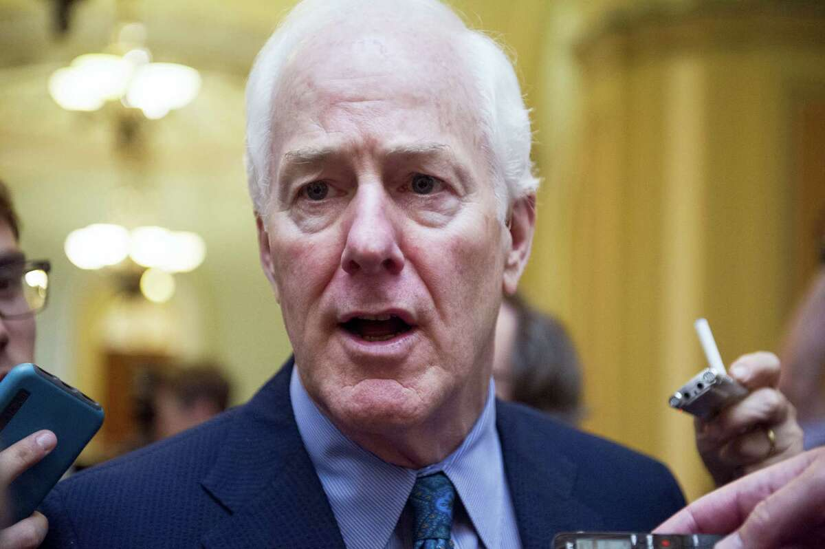 In this July 27, 2017, file photo, Senate Majority Whip John Cornyn of Texas talks to reporters as heads to the Senate on Capitol Hill in Washington. Top Senate Republicans think it's time to leave their derailed drive to scrap the Obama health care law behind them. And they're tired of the White House prodding them to keep voting until they succeed.