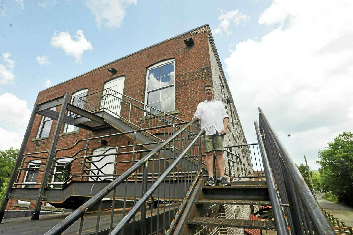 The Mad River Lofts, located in the smaller of two mill buildings at 10 Bridge Street in Winsted, is nearly complete. Above, Marty Goldin, who owns and renovated the properties.