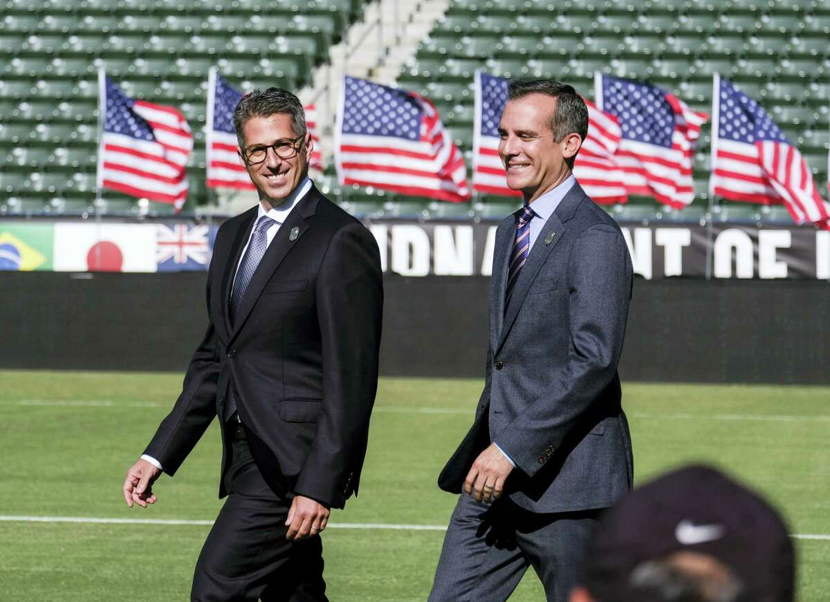 Los Angeles Mayor Eric Garcetti, right, and L.A. Olympic Committee leader Casey Wasserman arrive at a press conference to make an announcement for the city to host the Olympic Games and Paralympic Games 2028, at StudHub Center in Carson, outside of Los Angeles, Calif., Monday, July 31, 2017.