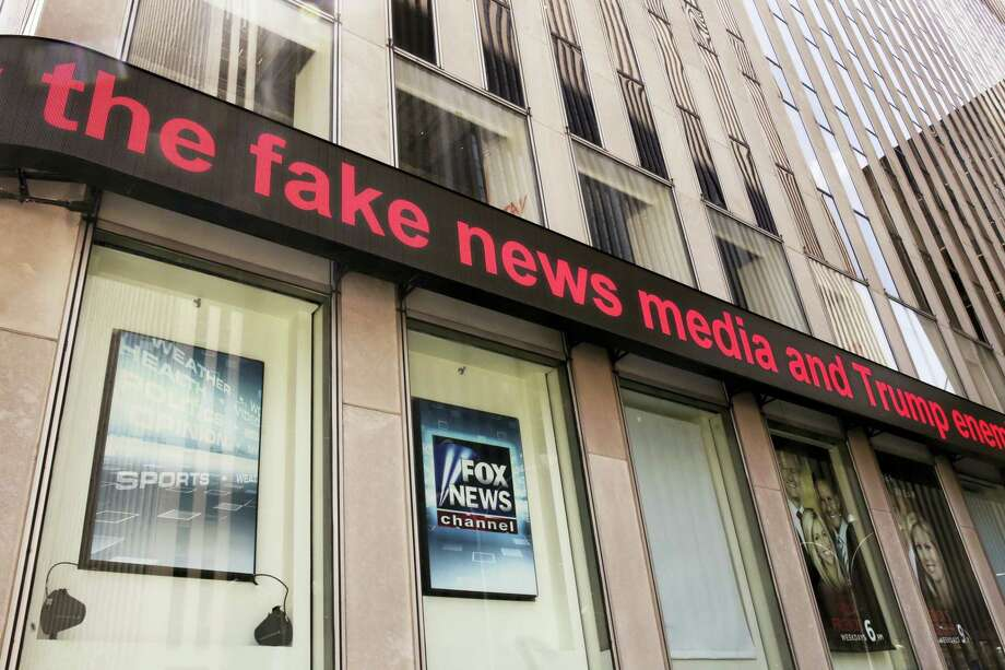 News headlines scroll above the Fox News studios in the News Corporation headquarters building in New York, Tuesday, Aug. 1, 2017.  Fox contributor Rod Wheeler, who worked on the Seth Rich case, claims Fox News fabricated quotes implicating the murdered Democratic National Committee staffer in the Wikileaks scandal and that President Donald Trump pressured Fox to publish the story. He sued Fox for defamation on Tuesday. Photo: Richard Drew / AP Photo  / AP