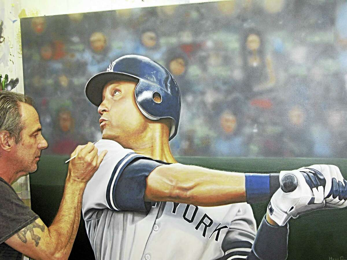 Marc Potocsky of North Branford takes brush to a Derek Jeter painting.