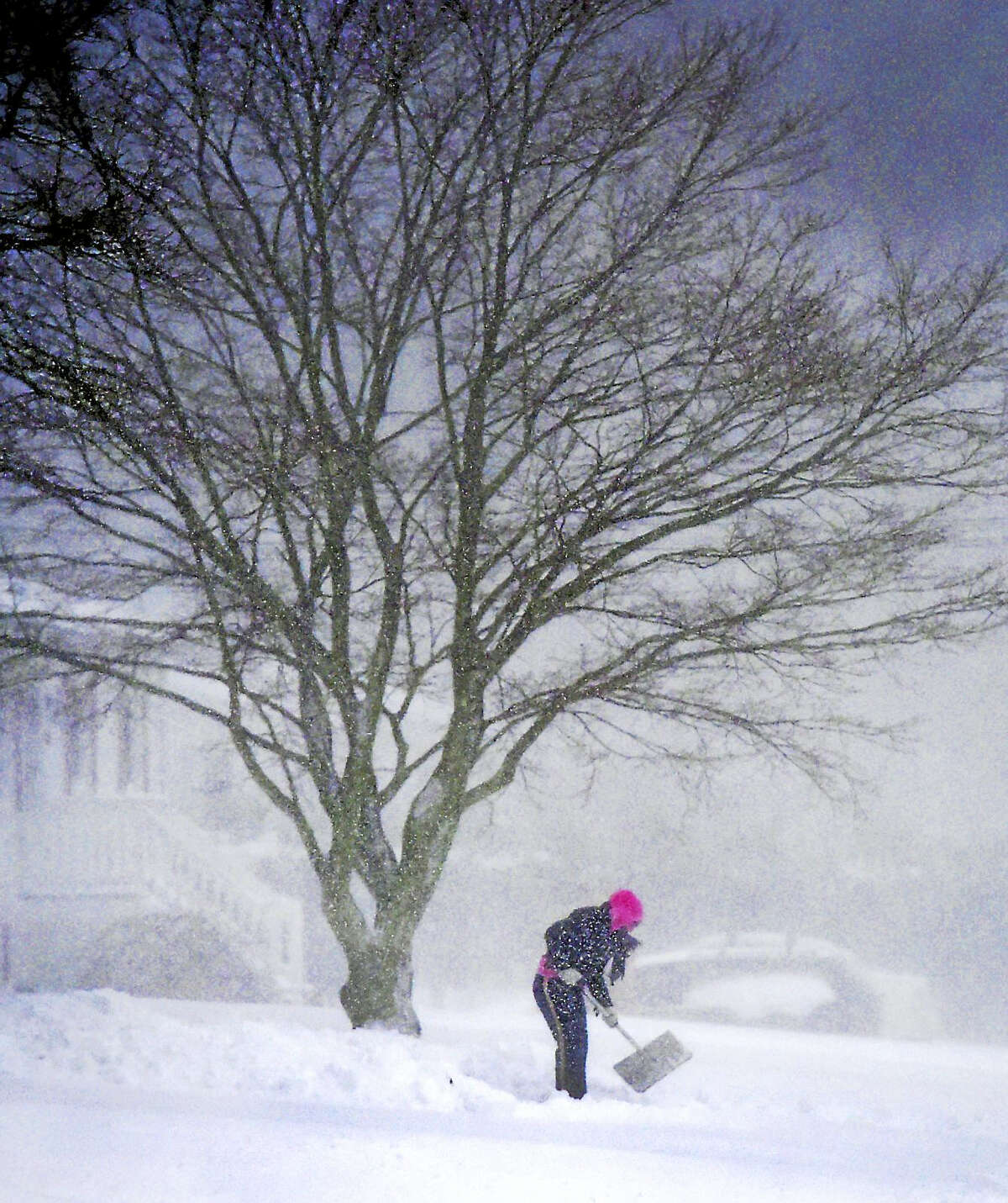 Driveway shoveling on Woodvale Road in Branford during the snowstorm in Branford on Thursday.