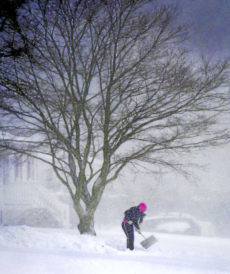 Driveway shoveling on Woodvale Road in Branford during the snowstorm in Branford on Thursday. Photo: Peter Hvizdak — New Haven Register  / ©2017 Peter Hvizdak