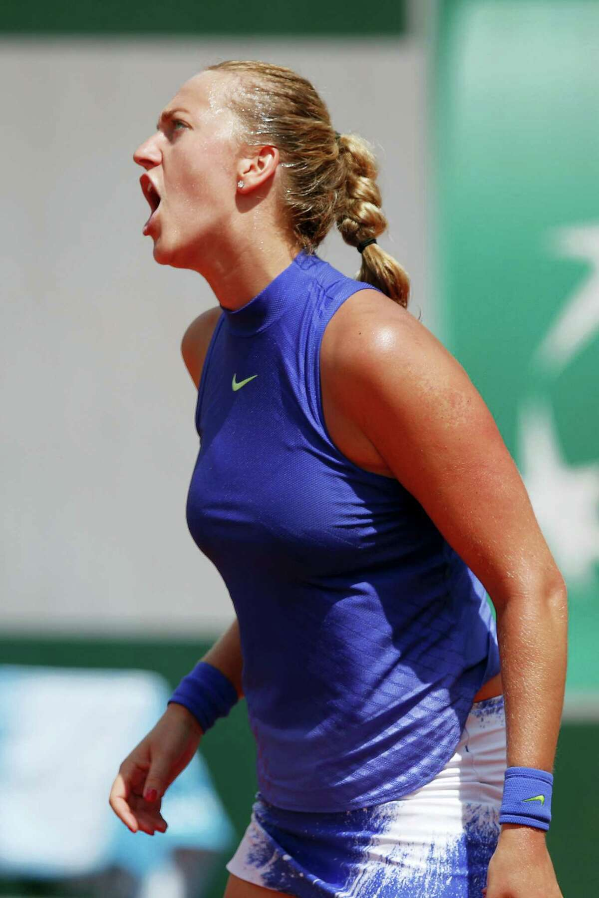 Petra Kvitova of the Czech Republic reacts after missing a shot against Bethanie Mattek-Sands of the U.S. during their second round match of the French Open tennis tournament at the Roland Garros stadium in Paris, France on May 31, 2017.