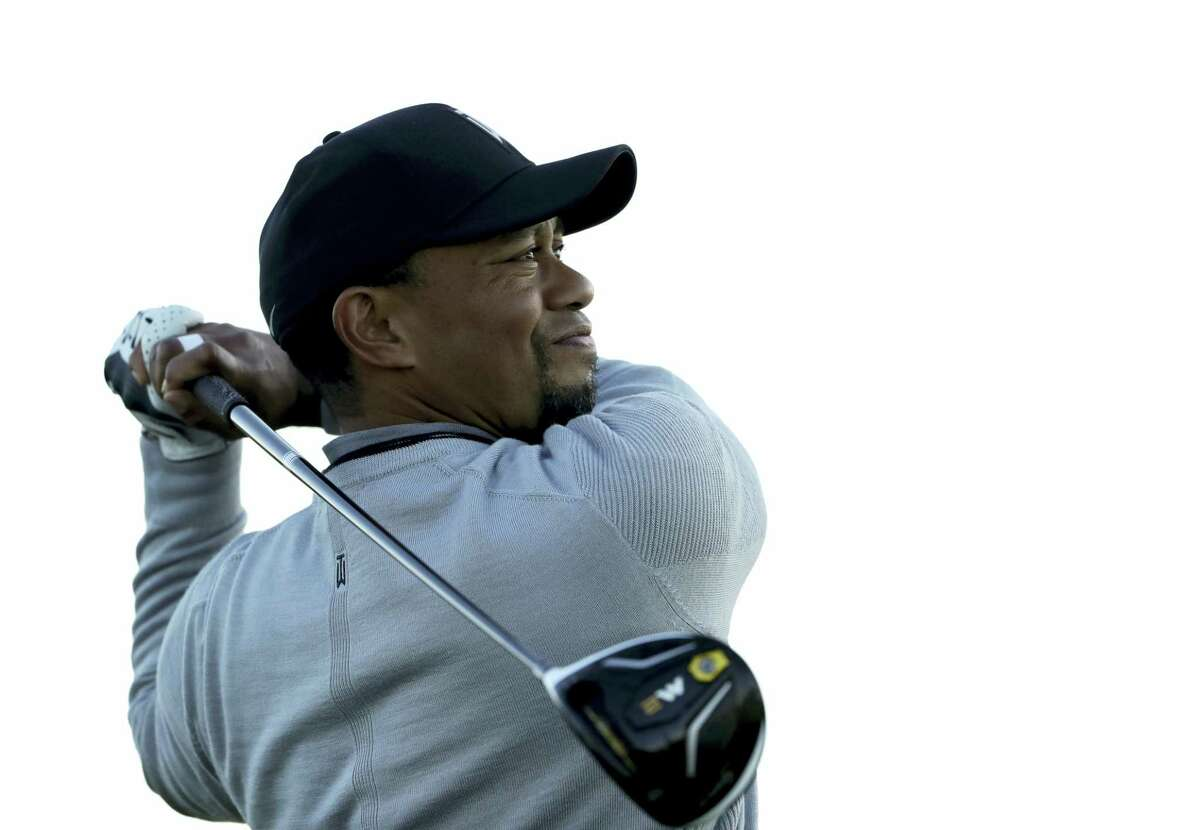 In this Jan. 25, 2017 photo, Tiger Woods watches his tee shot on the fifth hole of the north course during the Pro-Am event of the Farmers Insurance Open golf tournament, in San Diego. Police say golf great Tiger Woods has been arrested on a DUI charge in Florida. The Palm Beach County Sheriff's Office says on its website that Woods was booked into a county jail around 7 a.m. on May 29, 2017.