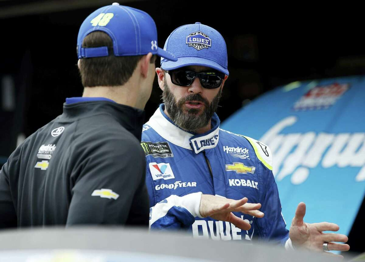Jimmie Johnson talks with a crew member after a practice session last week in Fontana, California.