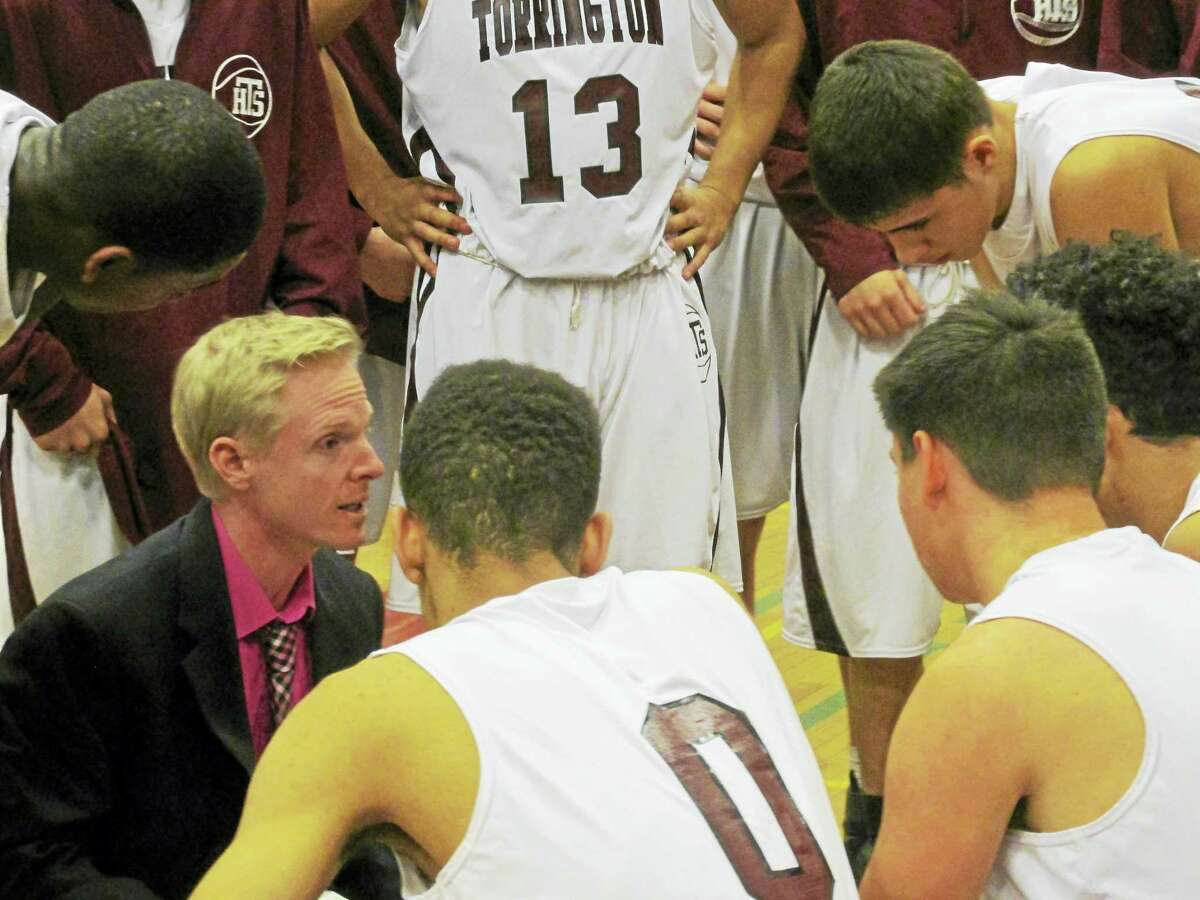 Photo by Peter Wallace Torrington Coach Eric Gamari tries to light a fire during Immaculate's rout at Torrington High School Monday night.