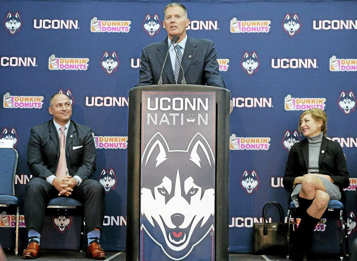 Randy Edsall speaks during an NCAA college football news conference as UConn athletic director David Benedict, left and university president Susan Herbst, right, listen, at Pratt & Whitney Stadium at Rentschler Field on Dec. 30, 2016 in East Hartford, Conn. Edsall, the most successful coach in UConn football history, is returning to the Huskies to try and right the ship one more time.