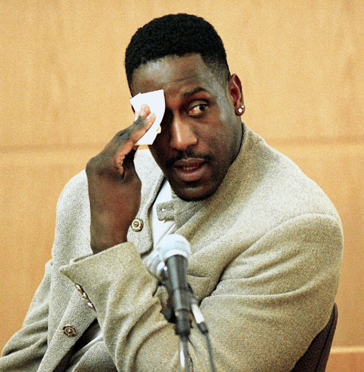 In this Dec. 4, 2000 photo, former North Carolina State basketball star Charles Shackleford wipes his forehead as he answers questions during Rae Carruth's murder trial in Charlotte, N.C. Police in North Carolina say Shackleford has been found dead in his home in Kinston. He was 50.