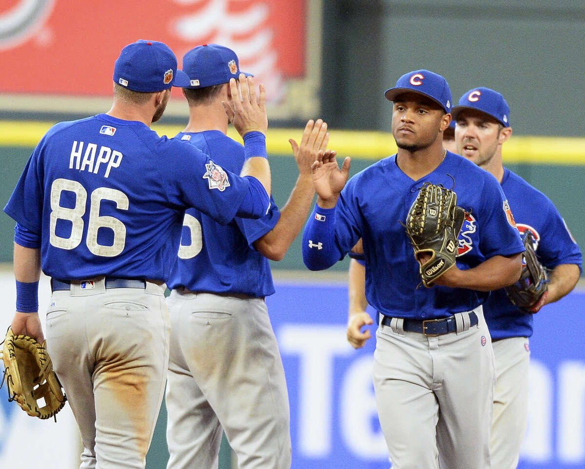 The Chicago Cubs celebrate a 6-3 win over the Houston Astros in an exhibition game Friday in Houston.