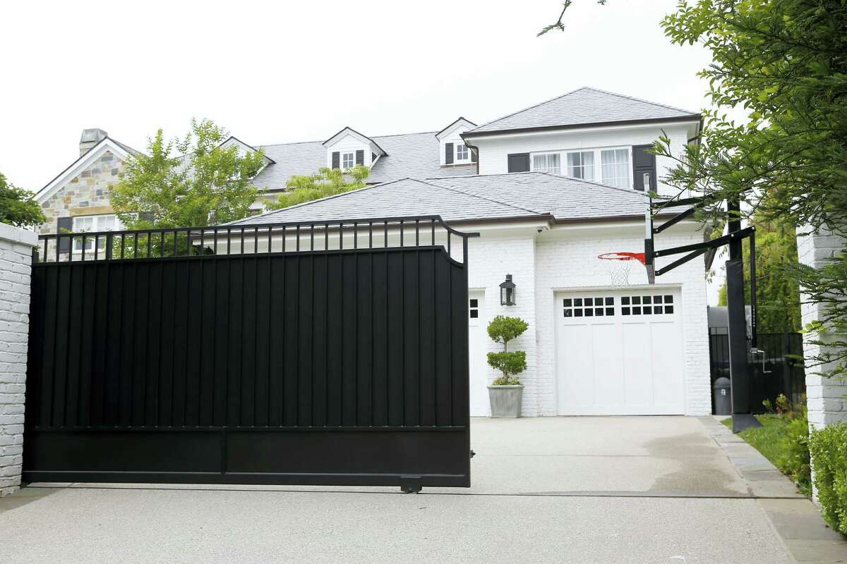 The front gate of a home belonging to Cleveland Cavaliers' LeBron James is freshly repainted Wednesday in Los Angeles. Police are investigating after someone spray painted a racial slur on the front gate of James' home in Los Angeles on the eve of the NBA Finals.