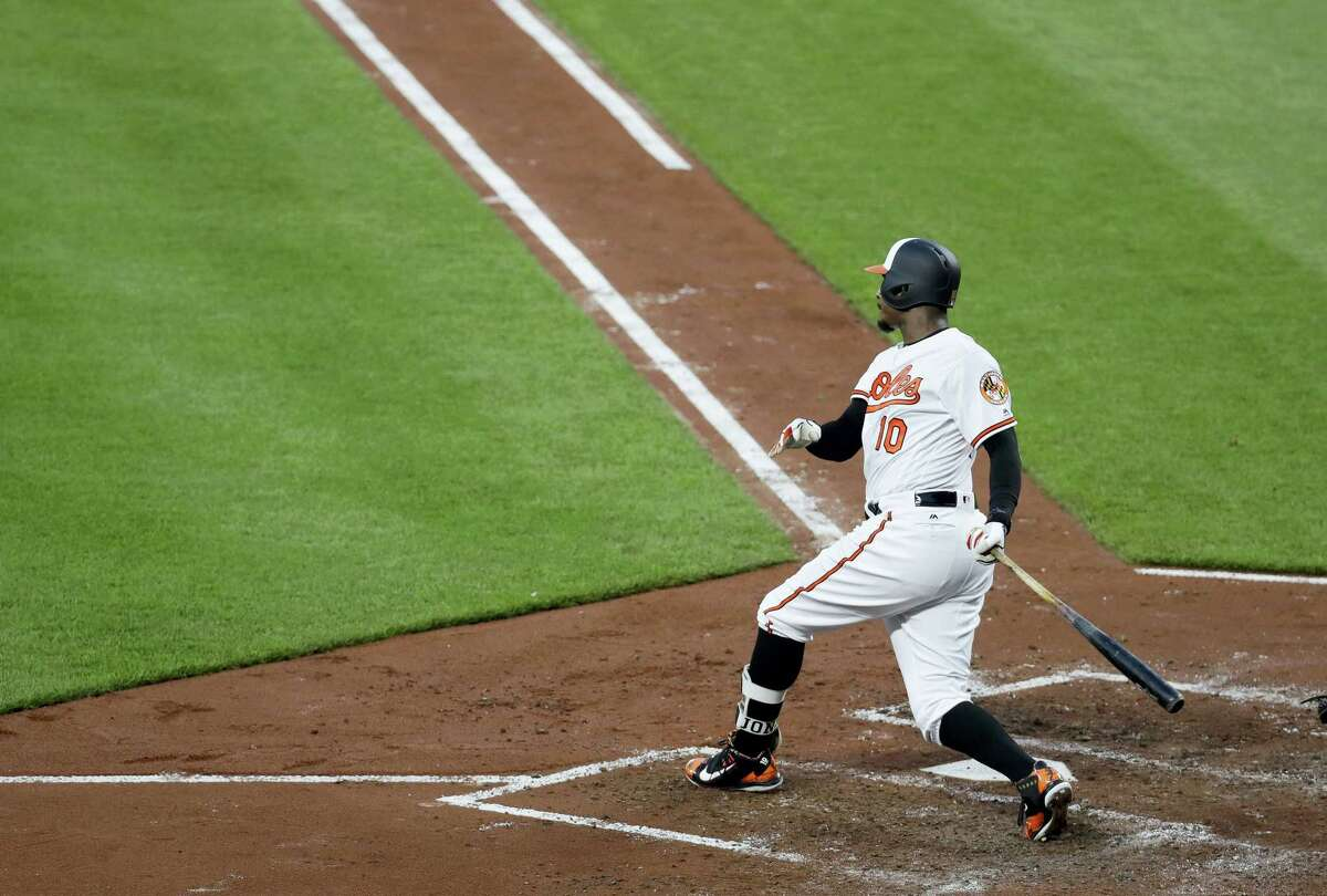 Baltimore Orioles' Adam Jones watches his RBI double during the third inning against the New York Yankees in Baltimore, Wednesday.