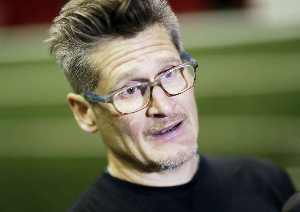 This Jan. 27, 2017 photo shows Atlanta Falcons general manager Thomas Dimitroff answering questions from the media at the NFL football team's practice facility in Flowery Branch, Ga. A string of emails that began in 2010 with the Atlanta Falcons head trainer and reached all the way to owner Arthur Blank showed a franchise worried about its 'excessive' reliance on painkillers to treat players and the potential embarrassment that could cause the team and the NFL.