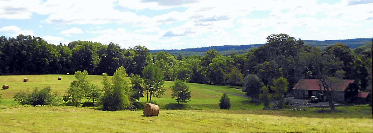 Hayfields at Triple Creek Farm, with the historic barn shown at lower right.