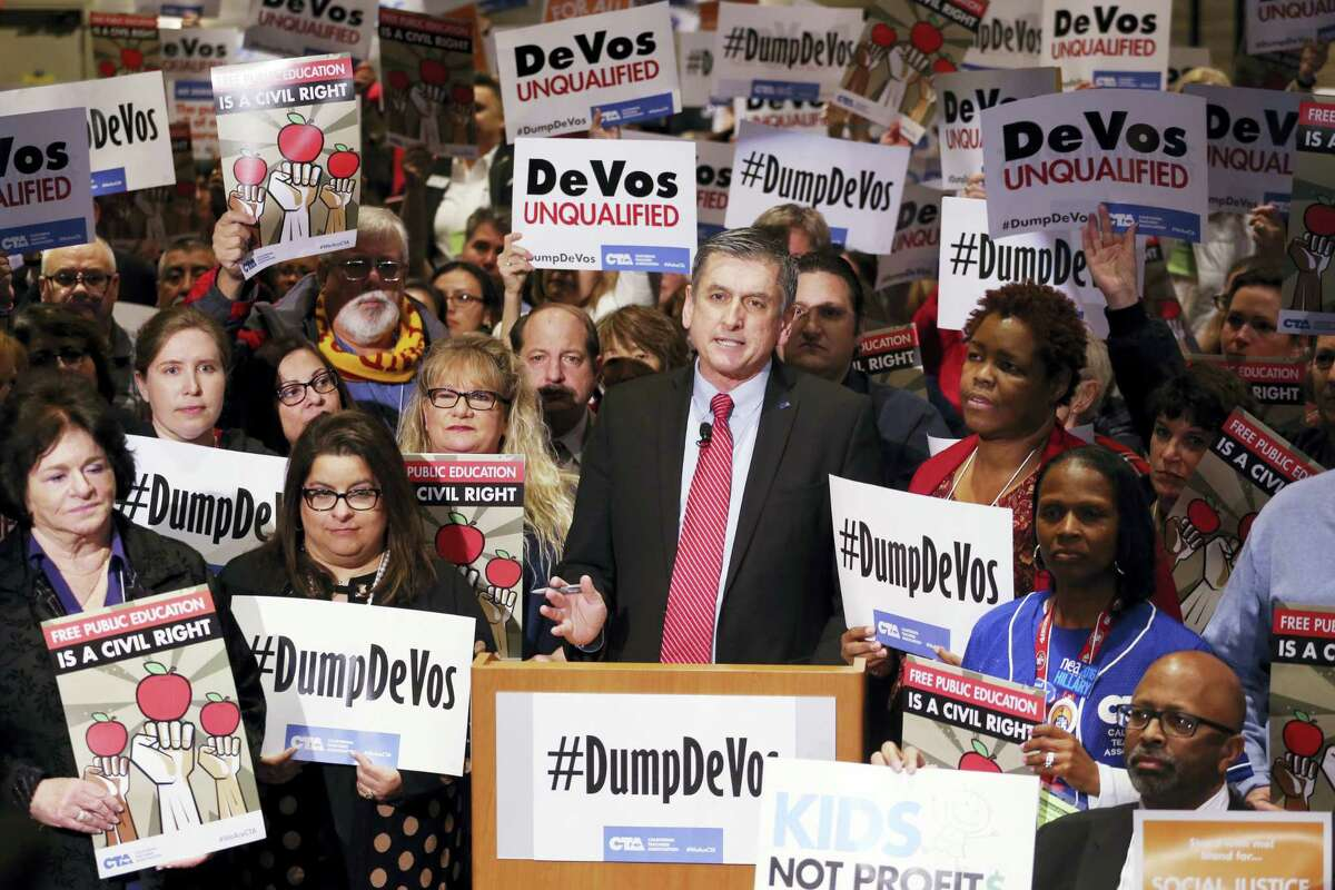 California Teachers Association president Erric Heins speaks as California educators voice their opposition to President Donald Trump's nomination of Besty DeVos as Secretary of Education, at a CTA meeting in Los Angeles Saturday, Jan. 28, 2017.