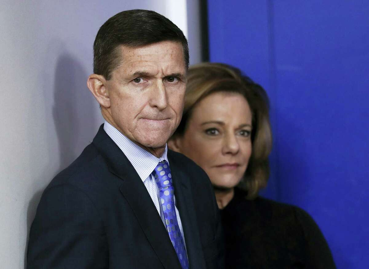 This Feb. 1, 2017, file photo shows then National Security Adviser Michael Flynn, joined by K.T. McFarland, deputy national security adviser, during the daily news briefing at the White House, in Washington. President Donald Trump says his former national security adviser, Mike Flynn, is right to ask for immunity in exchange for talking about Russia.
