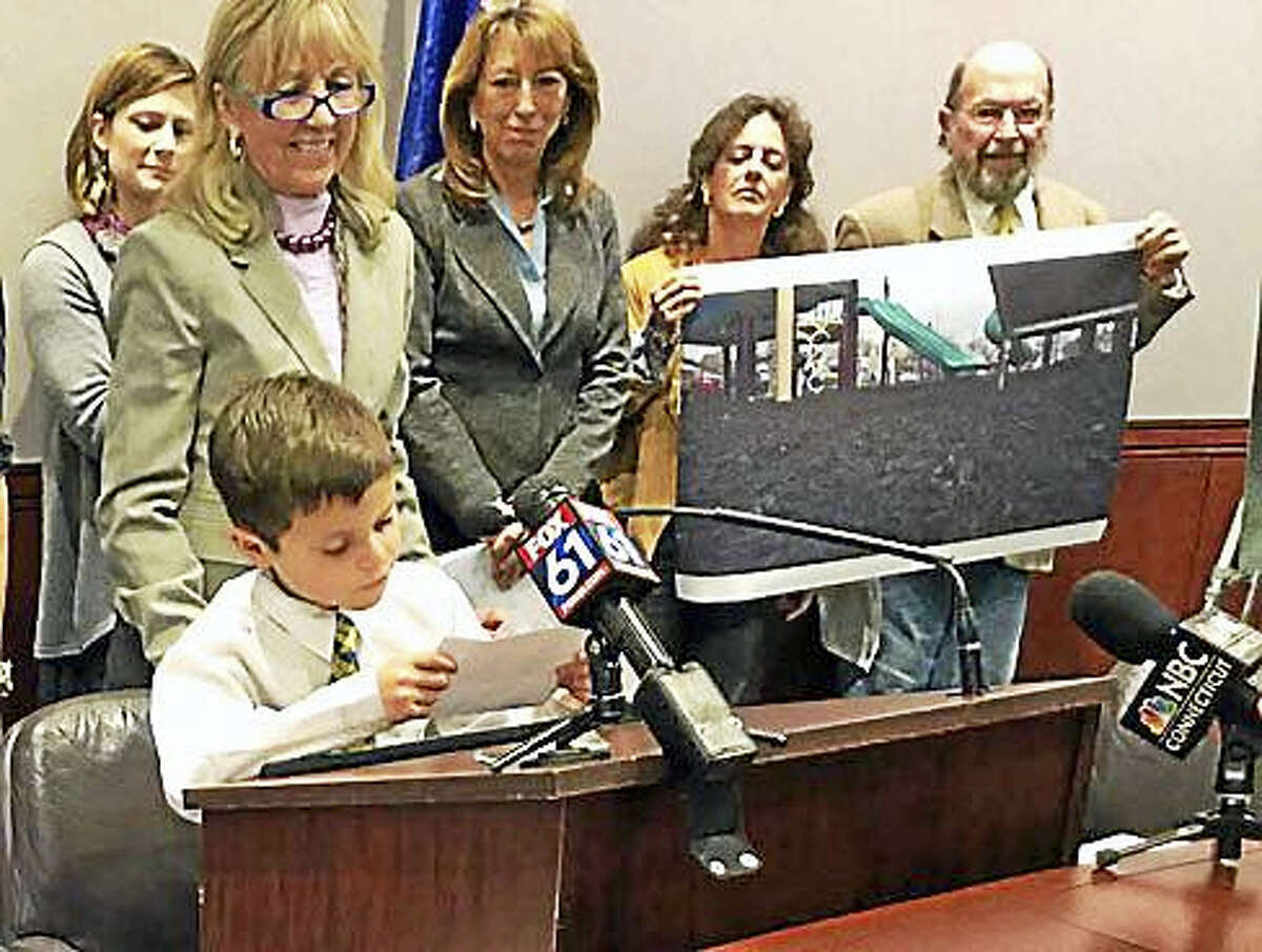 Connor Garrett of Hamden makes a plea to lawmakers to support bill prohibiting crumb rubber on playgrounds.