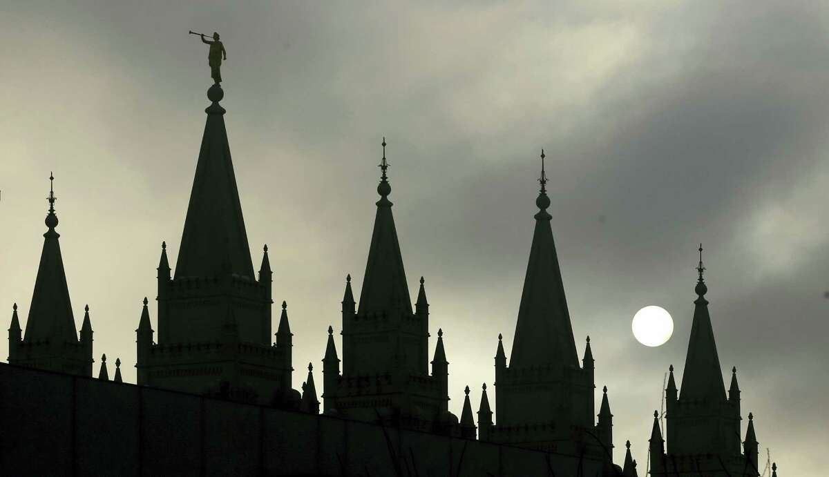 In this Feb. 6, 2013, file photo, the angel Moroni statue, silhouetted against a cloud-covered sky, sits atop the Salt Lake Temple, at Temple Square, in Salt Lake City. President Donald Trump's executive order temporarily banning refugees and nearly all travelers from seven Muslim-majority countries is raising concerns from the Mormon church, Gov. Gary Herbert and by hundreds of protesters marking the latest illustration of Utah's frosty relationship with Trump even though he carried the state.